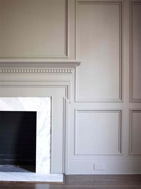gray paneling mantel surrounded by panel walls classic white