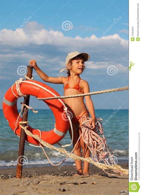 bathing suit little girl beach little girl in bathing suit standing on beach stock image
