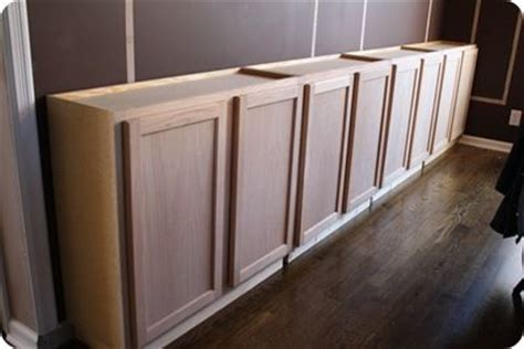 base cabinets for built ins using upper cabinets for the base of built in bookcases