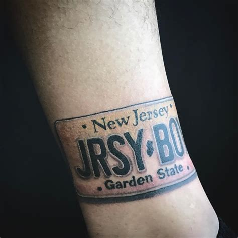 tattoo license jersey boy license plate on a leg