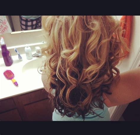 hair light on top and dark on the bottom dark brown underneath light strawberry blonde on top
