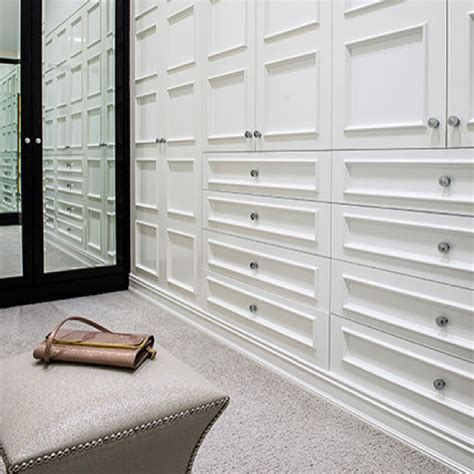 Walk In Closet Doors Walk In Closet With Upholstered Wardrobe Doors With Brass Nailhead Trim Transitional Closet