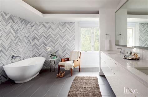 Modern White Bathroom with Herringbone Wall Tiles   Luxe