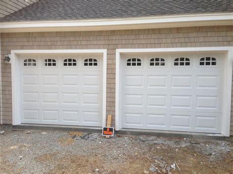 Overhead Garage Door Panels Haas Model 680 Steel Raised Panel Garage Doors In White With Cascade Glass Installed By
