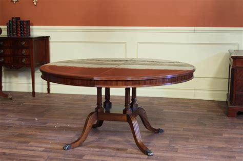 round dining room table with leaf 60 quot high end round to oval mahogany dining room table with