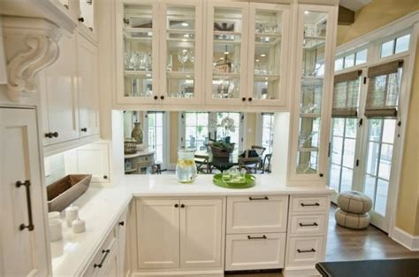 exceptional Kitchen Cabinet Door Covers #2: Glass-front-kitchen-cabinets-set-in-a-wooden-frame.jpg