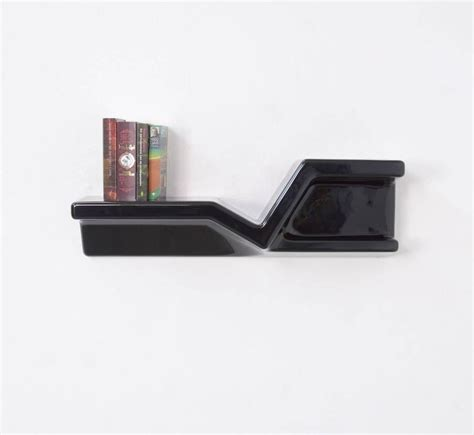 sculptural black plastic floating shelf by nani prina for