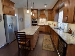 Kitchen laminate wood flooring in kitchen under white kitchen cabinets