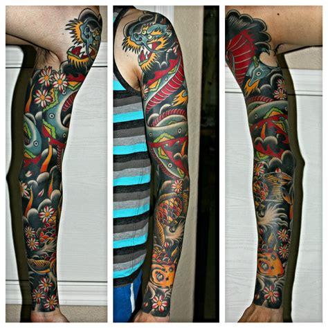 sleeping dragon tattoo jacksonville nc my sierra leone tattoo done by bart andrews at elite
