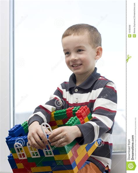 toy house for boy a boy and a toy house royalty free stock photos image 13185368
