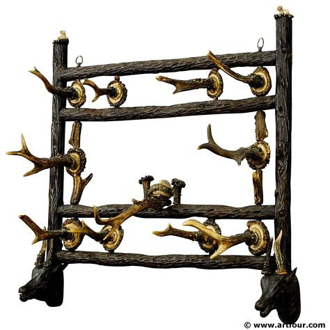 antique wooden carved wall rack with antler carvings