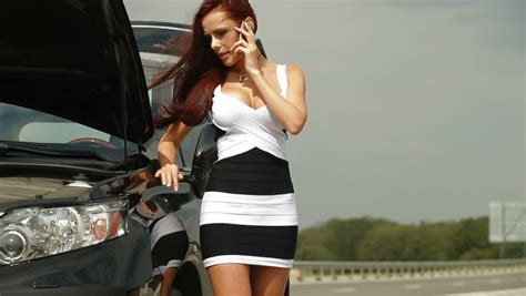 woman driver on the phone for car breakdown woman driver on the phone for car breakdown