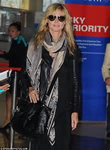 glamorous she sported a leather jacket over a sleek black dress