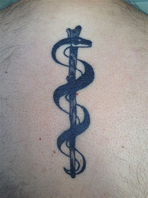 asclepius tattoo designs quot rod of asclepius in my upperback quot my husband s