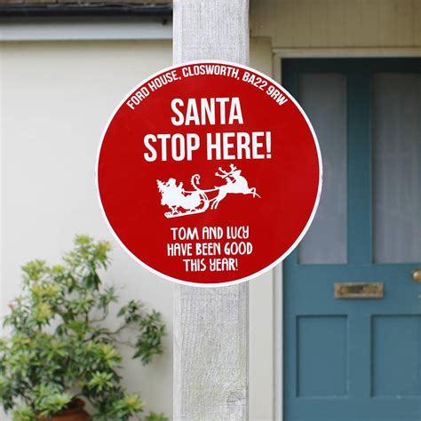 personalised santa stop here sign by jonny s sister