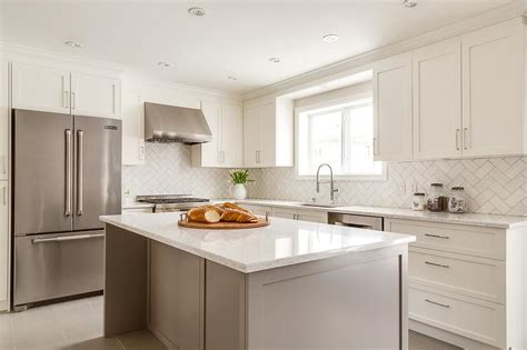 white shaker kitchen cabinets with grey island white shaker cabinets with white herringbone backsplash