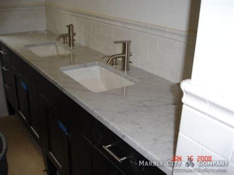 bianco carrara honed marble vanity at marble city company