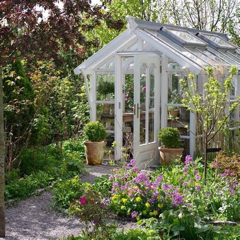 sweet white wood cottage greenhouse check