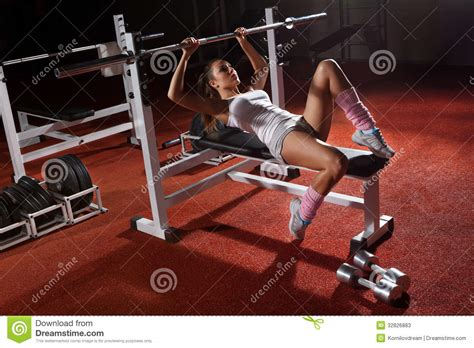 benching at the gym girl in gym bar bench press stock image image of
