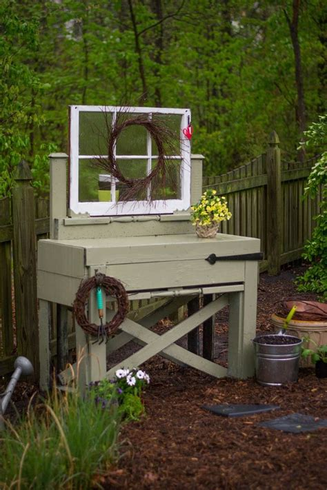 flower potting bench use an old window as part of an upcycled potting bench