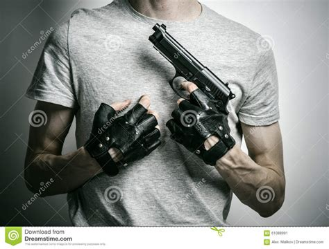 killer gun killer with gun on black background at the studio stock