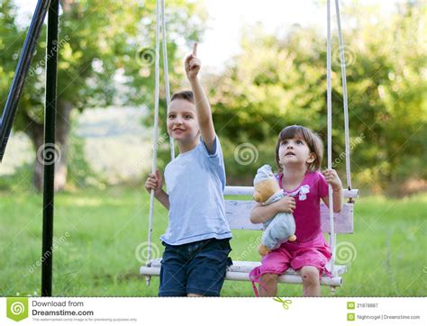 swinging sister brother and sister on a swing stock image image 21878887