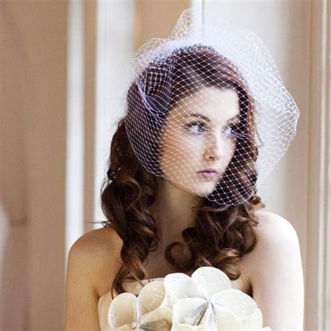 Wedding Hairstyles For Hair With Birdcage Veil by How To Put On A Birdcage Wedding Veil On With Hair
