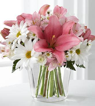 daisy lily bouquet add  roses