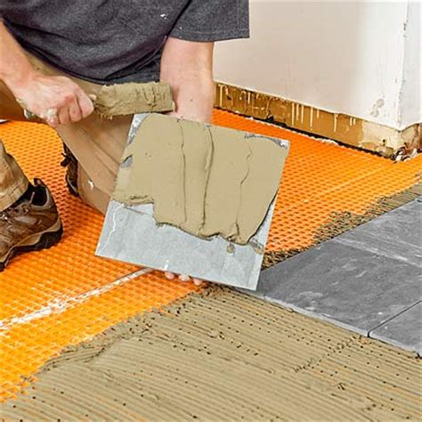 how do you lay tile in a bathroom how to lay a stone tile floor renocompare