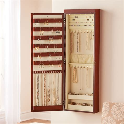 lighted wall mount jewelry armoire the 45 quot wall mounted lighted jewelry armoire hammacher