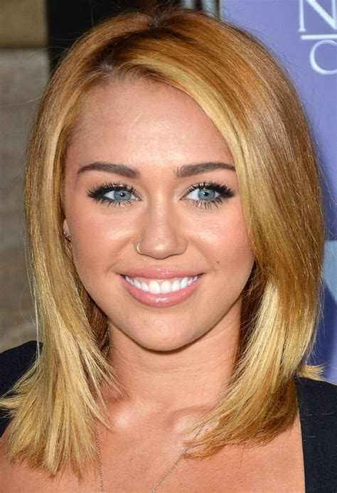 the name of mileys haircut miley cyrus medium haircuts with long side bangs png
