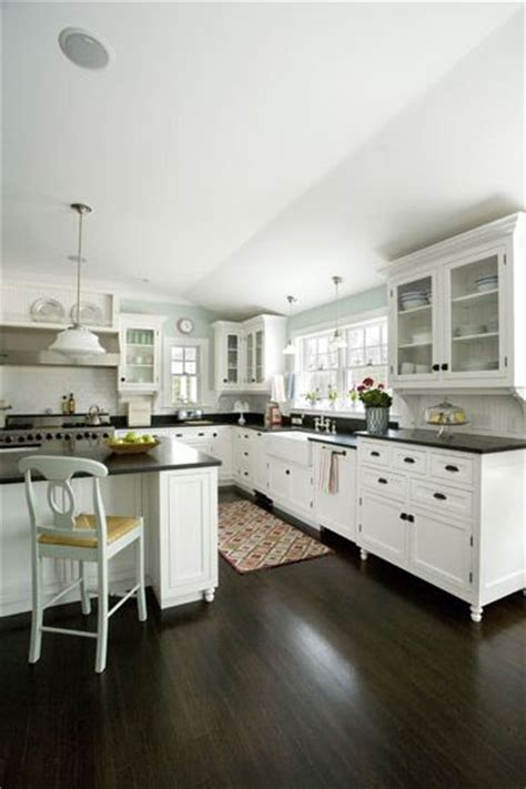 kitchens with white cabinets and dark floors white kitchen dark counter tops farm sink pay attention