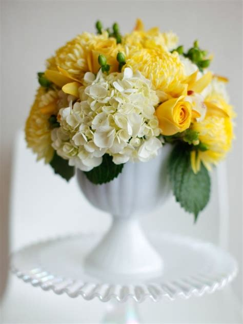 yellow flower arrangements centerpieces 25 best ideas about football mums on