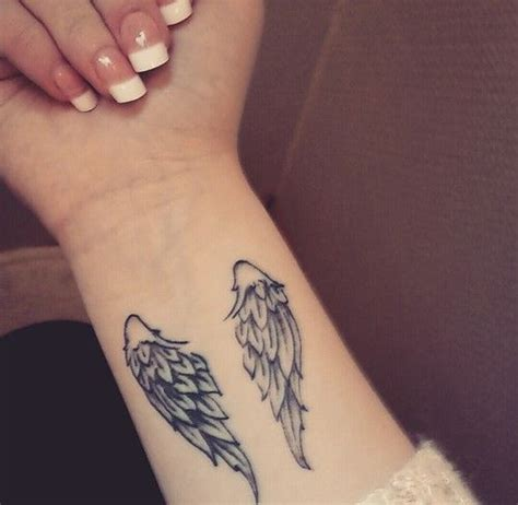 small angel wing tattoos on wrist best 25 small wing tattoos ideas on