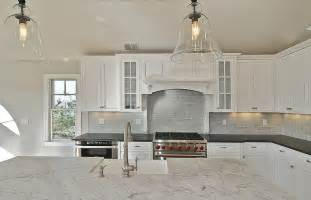 the brick tiles used this modern transitional style kitchen are white gray marble backsplash tile from