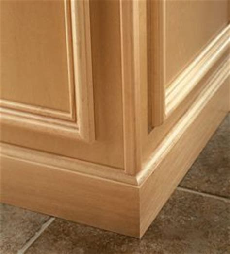 cove baseboard molding installed at base of floor cabinets