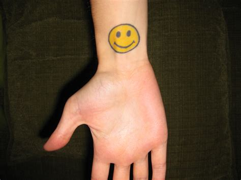 smiley face tattoo 10 scary and silly smiley designs
