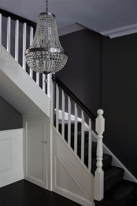 black banister white spindles under the stairs closet transitional entrance foyer