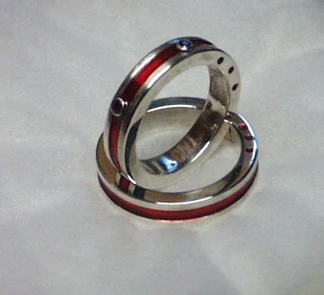Wedding Rings With Rubies by Repousse Sculpture And Metal Artist Sculptor
