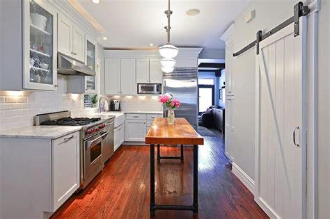 kitchen pantry  white barn door  rails