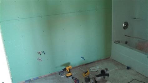 type of drywall for bathroom what you should know about water resistant greenboard