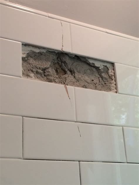 Tiles Cracking In Bathroom by Cracked Subway Tiles In Remodeled Bathroom