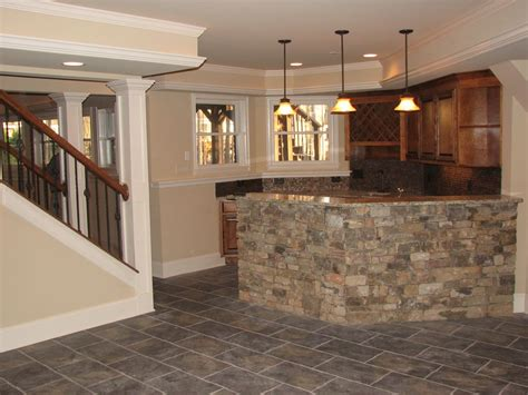 curved small basement bar design ideas with black iron
