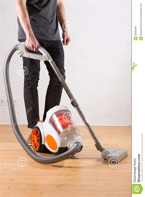 Vacuum Living Room In Cleaning With Vacuum Cleaner In Living Room Stock Photo