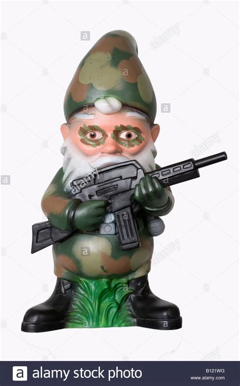 garden gnome in camouflage with machine gun stock photo