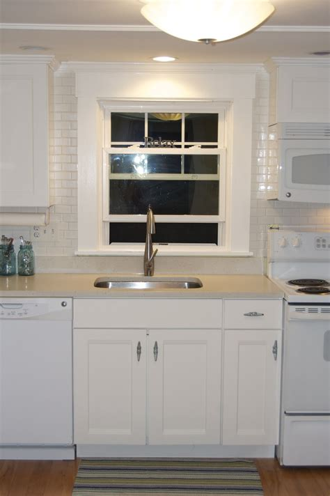 white kitchen subway tile backsplash modern kitchen concept with wood countertop also white
