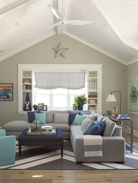 Hamptons Homes Interiors by Cool Grey Sectional Couch In Family Room Beach Style With