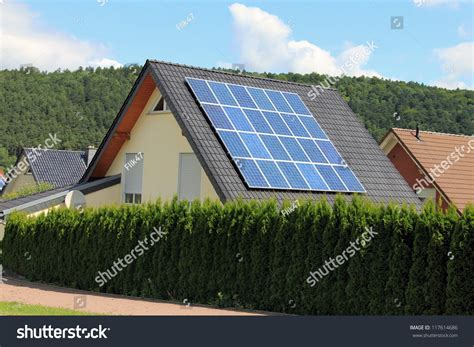 domestic use of solar energy domestic solar panels allow the production of clean energy stock photo 117614686