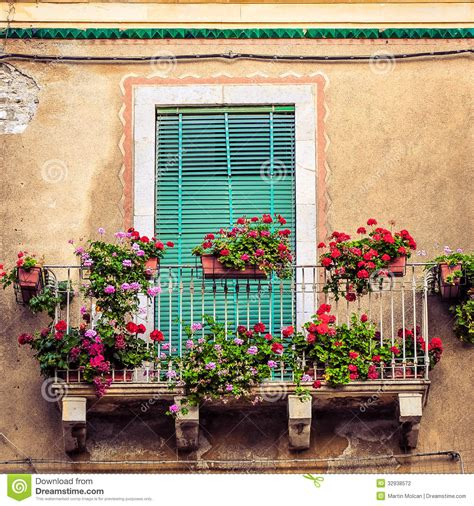 beautiful balcony with sunbeds and plants with beautiful beautiful vintage balcony with colorful flowers and door