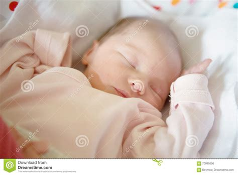newborn baby bed newborn baby girl sleeping in her crib stock photo image
